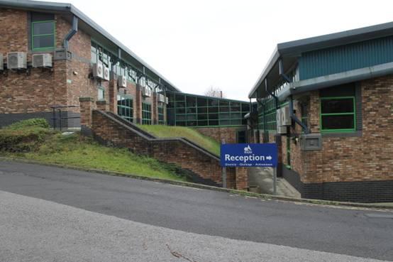 4. Grass bank area between buildings of the school
